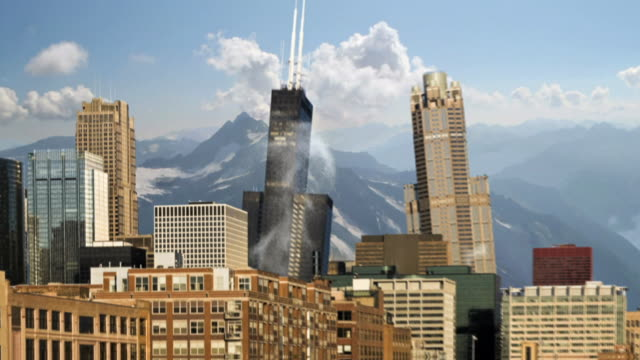 Wide Shot tilt-down zoom-out - Snowy mountains surround a city that crumbles during an earthquake. /