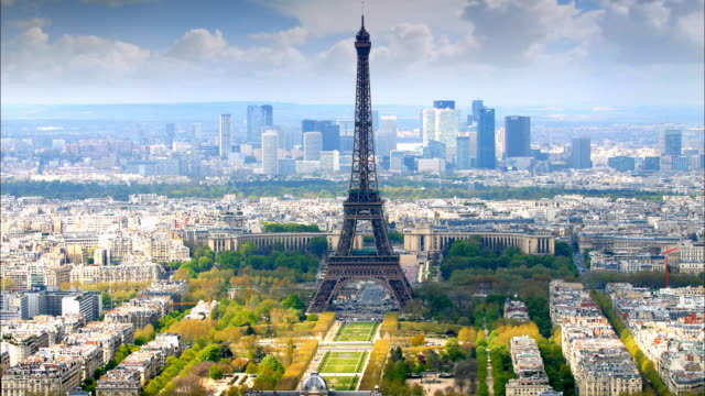 wide shot time lapse clouds and shadows passing over city skyline w/eiffel tower / paris - 2004 stock videos and b-roll footage
