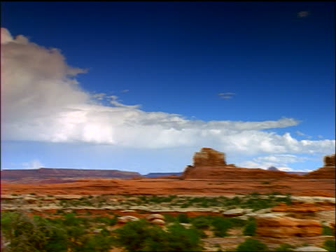 wide shot pan time lapse clouds over valley + buttes / canyonlands national park, utah - canyonlands national park stock videos & royalty-free footage
