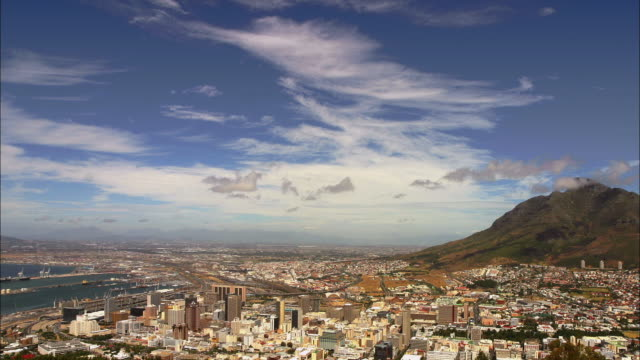 Wide shot time lapse clouds passing over City Bowl district / Cape Town, South Africa