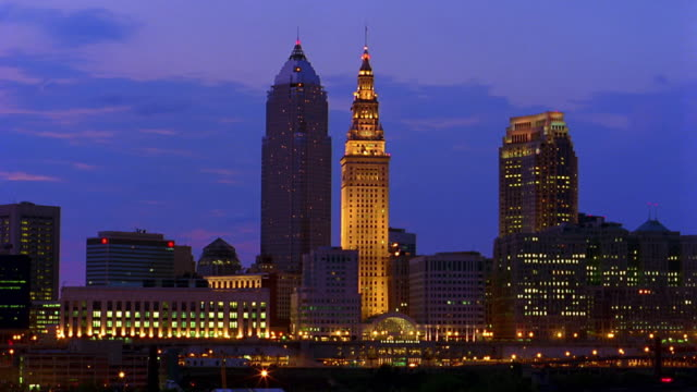 wide shot time lapse clouds rolling over cleveland skyline / dusk to night / ohio - cleveland ohio stock videos and b-roll footage