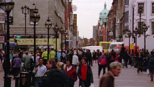 wide shot time lapse crowd of people walking on  north earl street / dublin, ireland - generic location stock videos & royalty-free footage