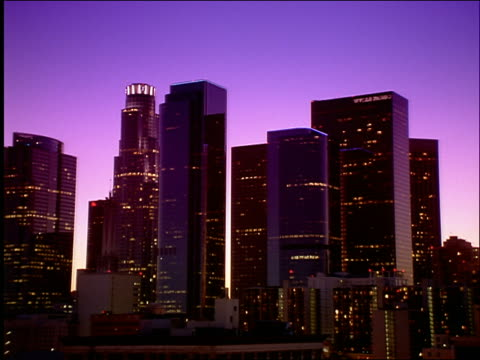 wide shot time lapse Los Angeles skyscrapers in skyline / twilight to night