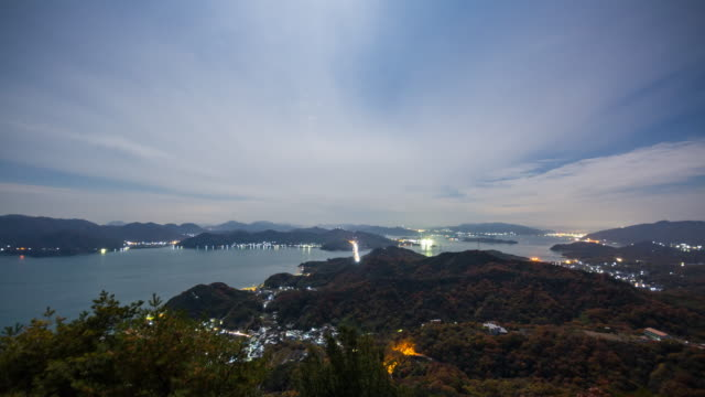 wide shot time lapse of a traffic commuting between islands over a bridge at night - hiroshima prefecture stock videos and b-roll footage