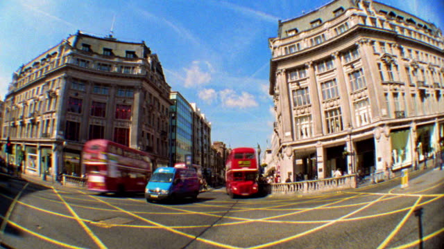 wide shot time lapse people crossing street and double-decker buses + traffic moving through oxford circus / london - oxford circus stock videos and b-roll footage