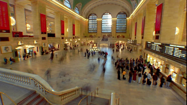 wide shot time lapse people walking in grand central terminal / manhattan, new york city - grand central station manhattan stock videos & royalty-free footage