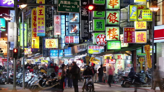 wide shot time lapse people walking under bright signs on snake alley (xi hua road) at night  / taipei, taiwan - chinese language stock videos & royalty-free footage
