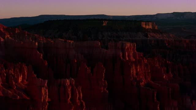 wide shot time lapse sky and rock formations in bryce canyon brightening at dawn / utah - 1989 stock videos & royalty-free footage