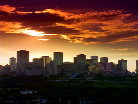 wide shot time lapse slow moving clouds over skyline of edmonton at sunset / alberta / filter - edmonton stock videos and b-roll footage