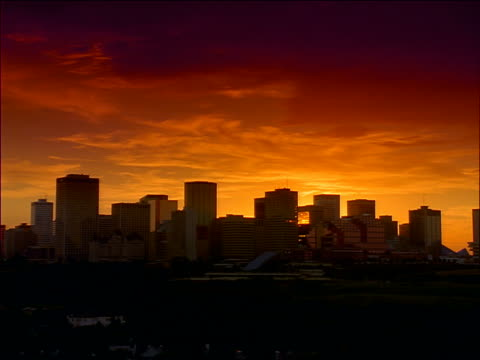 wide shot time lapse sunset with clouds over skyline of edmonton / alberta / filter - edmonton stock videos and b-roll footage