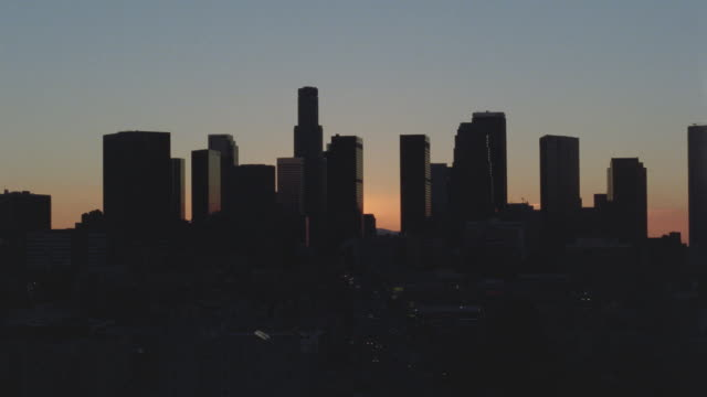 Wide shot time lapse traffic and sunrise / downtown Los Angeles