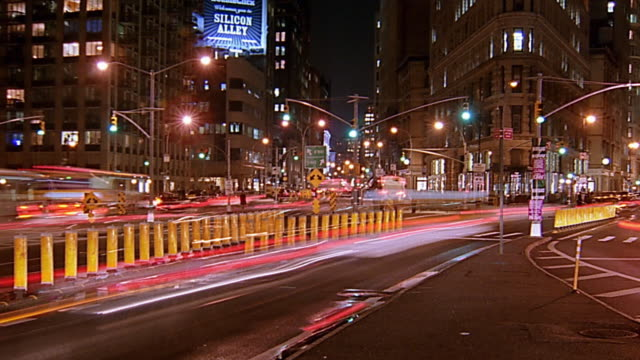Wide shot time lapse traffic at night / Flatiron District, New York City