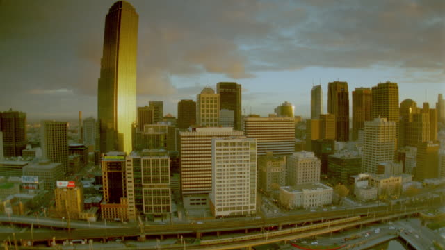 wide shot time lapse traffic in front of + clouds moving behind melbourne skyline at sunrise / victoria, australia - 1999 stock videos & royalty-free footage