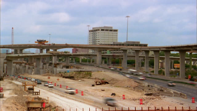 wide shot time lapse traffic on high five road interchange construction project / dallas - 2004年点の映像素材/bロール