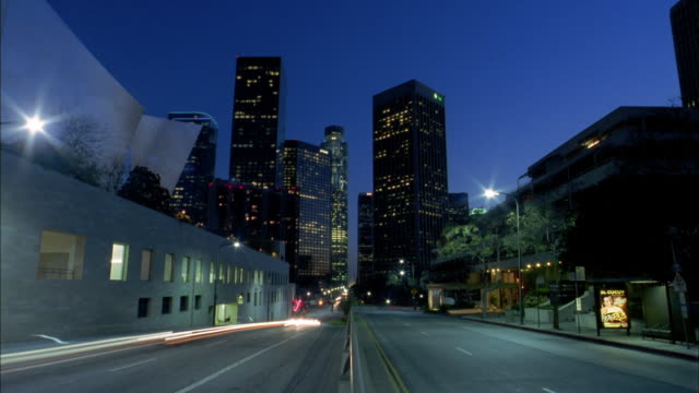 wide shot time lapse traffic on road toward downtown los angeles - 2004 stock-videos und b-roll-filmmaterial