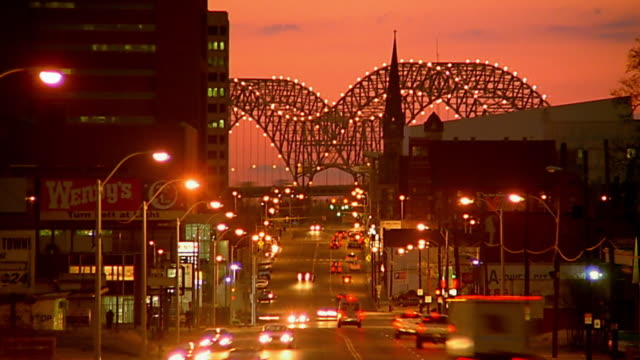 wide shot time lapse traffic on street at dusk / memphis - memphis tennessee stock videos & royalty-free footage
