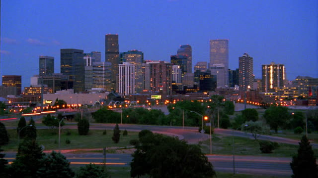 wide shot time lapse traffic on streets and highways with denver skyline in background / colorado - 1993 stock videos & royalty-free footage