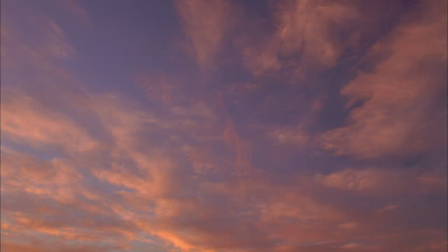 wide shot time lapse wispy clouds at sunset - wispy stock videos and b-roll footage