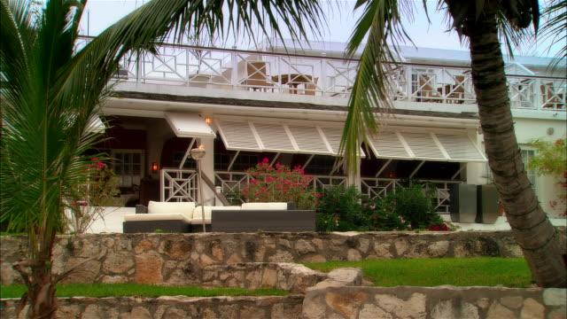 wide shot torch burning outside beach house/ harbor island, bahamas - holiday villa stock videos & royalty-free footage