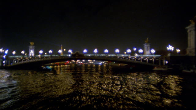wide shot tour boat point of view under pont alexandre iii bridge on river seine / paris, france - boat point of view stock videos & royalty-free footage