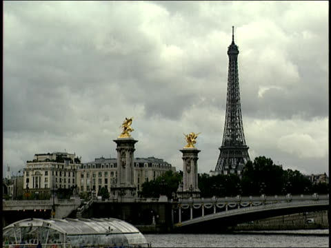 2006 wide shot tourboat traveling on seine river under pont alexandre iii near gold statues and eiffel tower/ paris, france - pont alexandre iii stock videos & royalty-free footage