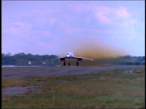 wide shot tracking shot of concorde jet taking off / new york - british aerospace concorde stock videos and b-roll footage