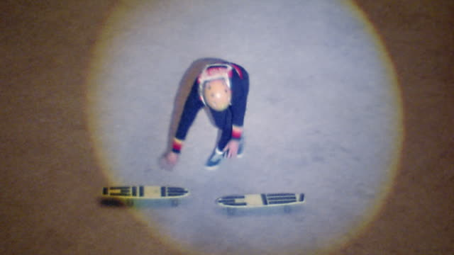 vidéos et rushes de 1976 wide shot tracking shot spotlit man doing handstand on 2 skateboards / turning 360s on 1 board - 1976