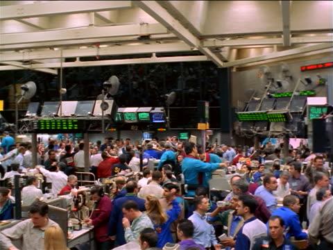 wide shot pan traders beneath electronic displays on exchange floor / coffee, sugar + cocoa exchange, nyc - bull market stock videos & royalty-free footage