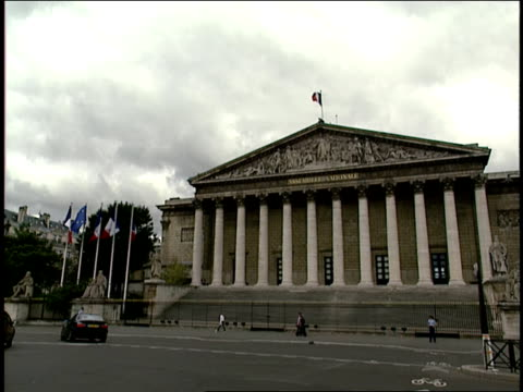 2006 Wide shot Traffic and pedestrians crossing in front of Assemblee Nationale building/ Paris, France