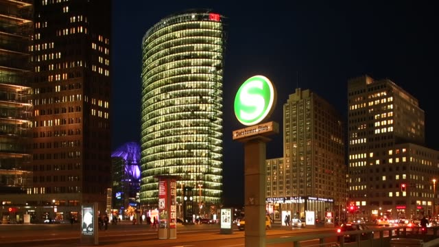 wide shot traffic and people passing potsdamer platz at night shot in berlin germany on february 18th 2014 - road signal stock videos & royalty-free footage
