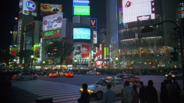 wide shot traffic at shibuya crossing / pedestrians waiting to cross street / tokyo, japan - 2003 stock videos & royalty-free footage