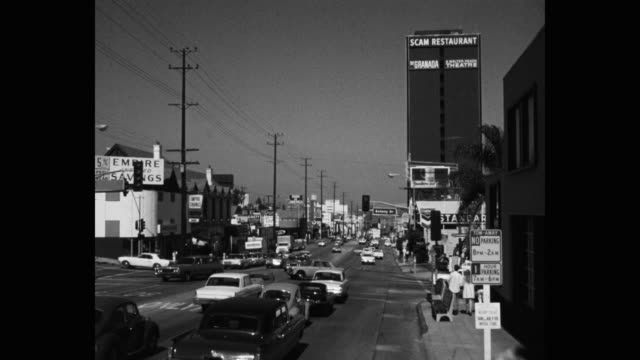 1968 wide shot traffic moving on sunset boulevard, los angeles, california, usa - commercial sign stock videos & royalty-free footage