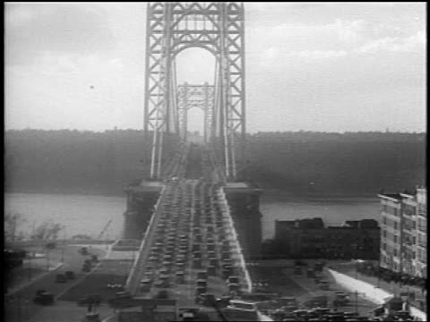 vídeos de stock e filmes b-roll de b/w 1931 wide shot traffic on george washington bridge after dedication ceremony / nyc - 1931