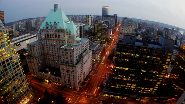 Wide shot Traffic surrounding Fairmont Hotel Vancouver/ Vancouver, British Columbia, Canada