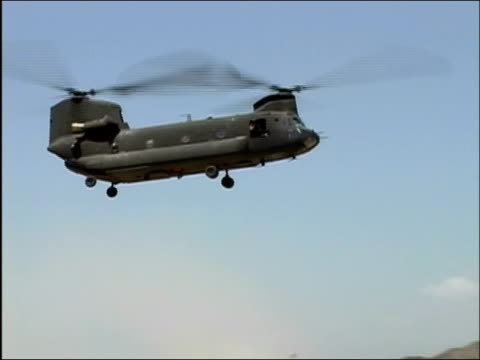 wide shot transport helicopter landing on runway at fob salerno / khost afghanistan / audio - operazione enduring freedom video stock e b–roll
