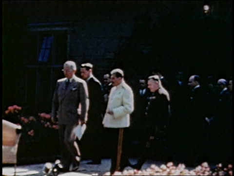 wide shot truman, stalin walking to chairs / waiting for churchill who walks up / potsdam, germany - potsdam brandenburg stock videos & royalty-free footage