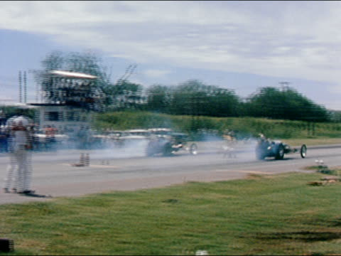 1959 wide shot two buggy-style race cars taking off and drag raccing on track