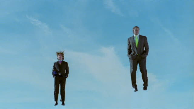 stockvideo's en b-roll-footage met wide shot two business men alternating jumping up and down on trampoline with hands in pockets - trampoline