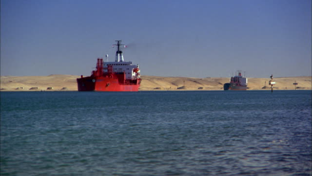 wide shot two oil tanker ships in suez canal / egypt - suez canal stock videos & royalty-free footage