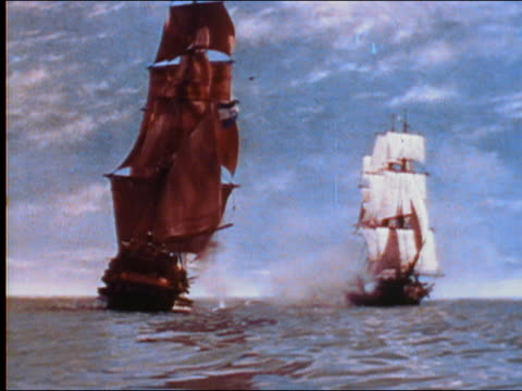 1956 wide shot two spanish galleon ships battling with cannons on ocean /  audio - battle stock-videos und b-roll-filmmaterial