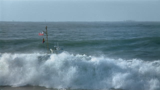 wide shot us coast guard boat cresting over large waves / california, usa - guardia costiera video stock e b–roll