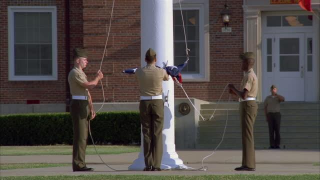 wide shot us marines raising us flag - patriotism stock videos & royalty-free footage