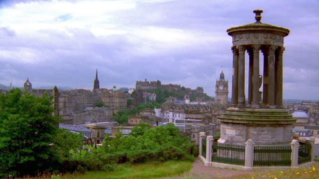 Wide shot view from Calton Hill of Edinburgh with Balmoral Hotel and Edinburgh Castle in far background / Scotland