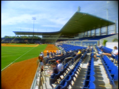 wide shot view from left field of baseball stadium with time lapse crowd starting to fill stands / fort myers, fl - fort myers stock videos & royalty-free footage
