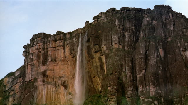 Wide shot view of Angel Falls cascading down cliff face of Auyun-tepui / Canaima National Park / Venezuela