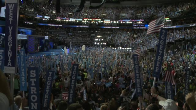 A wide shot view of Democratic supporters cheering for Hillary Clinton during her speech at the Democratic National Convention Democratic National...