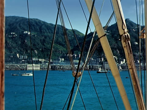 1939 wide shot view of harbor and waterfont from boat/ hong kong - 1939 stock-videos und b-roll-filmmaterial