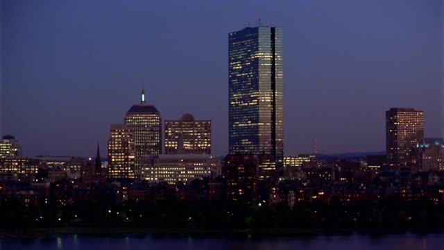 Wide shot view of John Hancock building at night / Boston