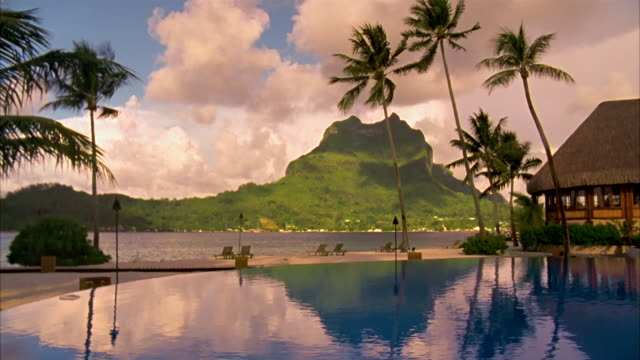 wide shot view of mount otemanu from infinity pool at resort/ bora bora - infinity pool stock videos & royalty-free footage
