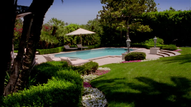 wide shot view of swimming pool in backyard area - lockdown stock videos & royalty-free footage